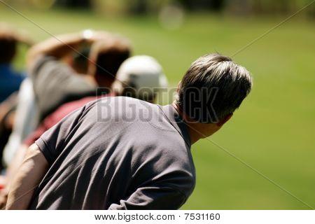 Golf Spectator Waits For The Ball