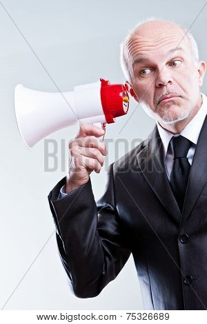 Man Using A Megaphone With Ears Instead Of Mouth