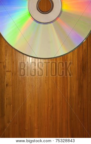 Compact disc on a Wooden Background with copy space poster