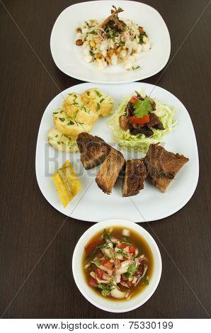 fritada with mote con chicharron fried pork hominy toasted corn nuts Ecuadorian food