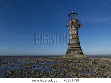Ruined Derelict Lighthouse, Space To Top Left. Whiteford Sands, Gower Peninsula, South Wales. Blue S
