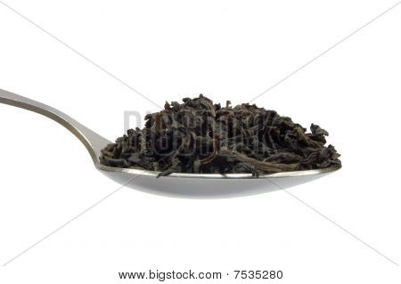 Teaspoon With Dark Black Tea Leaf