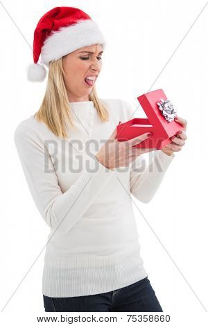 Disappointed blonde opening christmas gift on white background