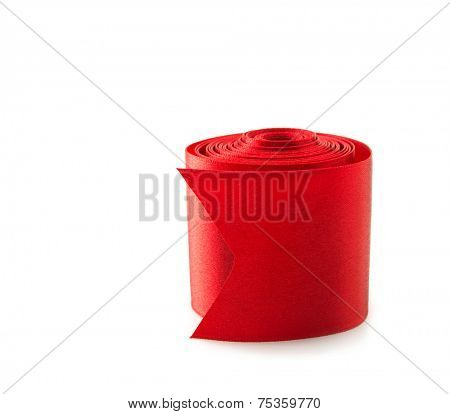 Rolled reel of red ribbon , isolated on white. Preparation for gift wrapping.