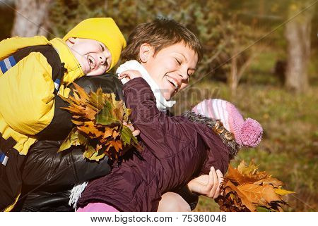 happy mather and children in park