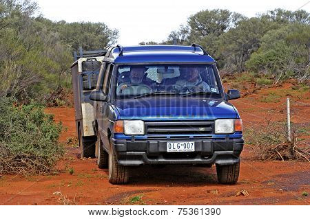 A Group Of Tourists With A Car-ground Lost In The Australian Bush