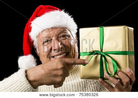 Broadly Grinning Aged Male Pointing At Golden Gift