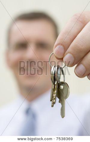 Real-estate Agent Handing Over Keys