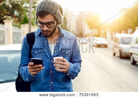 Modern Young Man With Mobile Phone In The Street.