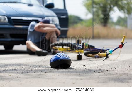A boy suffering after a bike accident with a car poster