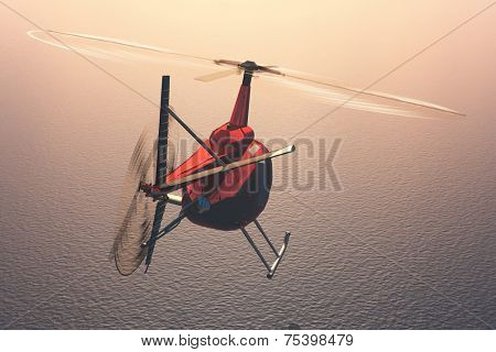 Civilian helicopter over the sea.