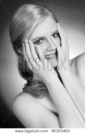 Beautiful Woman Happy Smiling Holds Hands Over Face Embarrassed