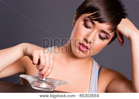 Young Teen Female Just 18 Putting Out Cigarette After Smoking