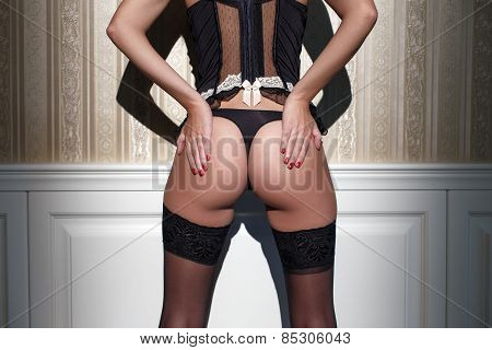 Sexy Woman Ass At Vintage Wall