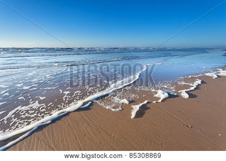 North Sea Sand Beach And Blue Sky
