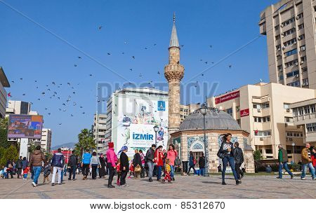 Tourists Walking Near Ancient Camii Mosque In Izmir