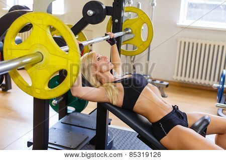 Sports Woman In The Gym.