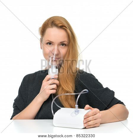 Young Woman Using Nebulizer Mask For Respiratory Inhaler Asthma Treatment