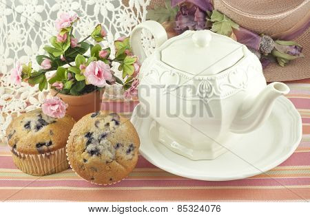 Teapot With Blueberry Muffins