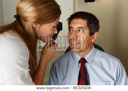 Young eye Doctor during a patient examination in her office