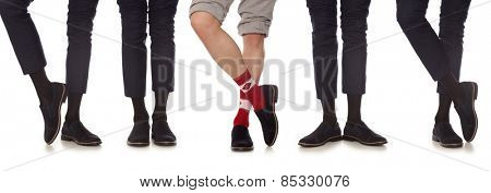 Maverick. Man leg in suit and colorful socks, isolated on white