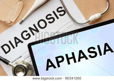 Tablet with diagnosis Aphasia and stethoscope.