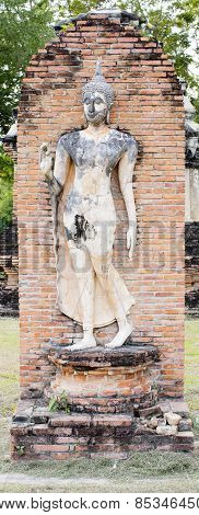 Buddha Statue in Wat Mahathat Temple in Sukhothai Historical park at sunrise Thailand poster