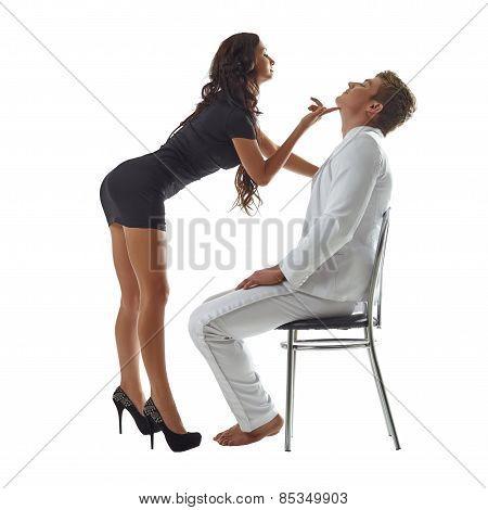 Flirtatious girl dancing striptease to her beloved