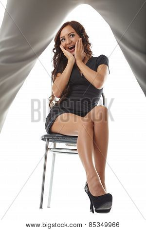Pretty leggy brunette stares at male stripper