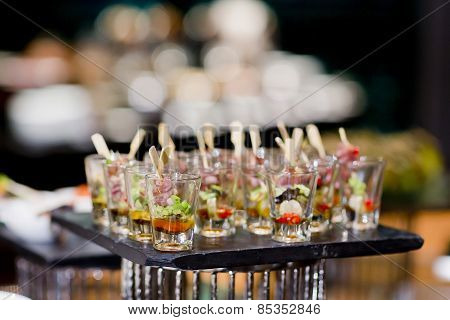 Closeup of sweet tasty dessert on modern table buffet poster