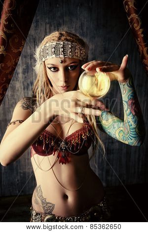 Magnificent fortune teller holding crystal ball. Divination. Magic. Halloween.