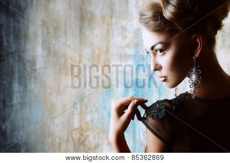 Stunning female model in black evening dress. Fashion shot.