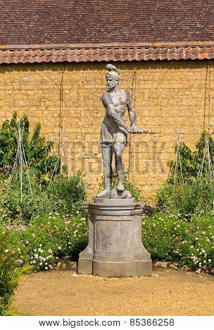 Statue in gardens at Barrington Court near Ilminster Somerset England uk Tudor manor house