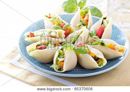 Vegetable salad served in jumbo pasta shells poster