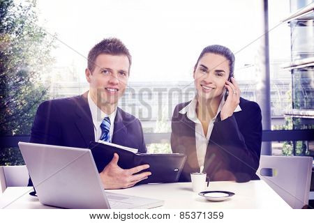 Happy businesspeople working at office on a sunny day. Lensflare. poster