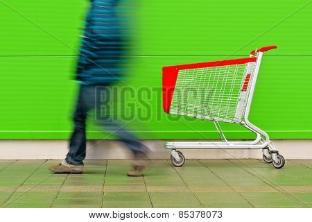 Man Walking By Empty Shopping Cart Trolley