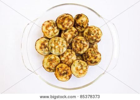 Indian cuisine ~ fried puffed balls made from mould filled with dough of rice powder and fillings