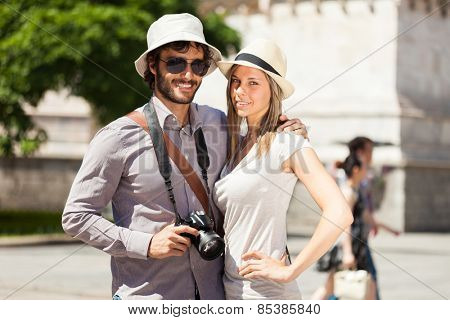 Couple of tourists walking in a city