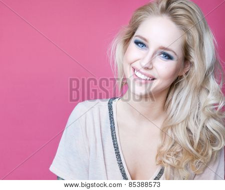 Young attractive laughing blonde happy woman expressive portrait beauty concept