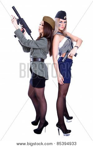 Two Women In The Military Uniform With A Guns