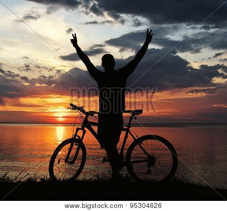 Silhouette Of A Man With A Mountain Bike