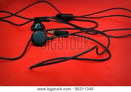 Headphones on red background