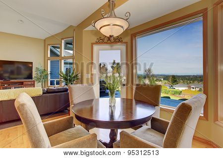 Simplistic Dinning Area With Great View, And Light Toned Hardwood Floor.