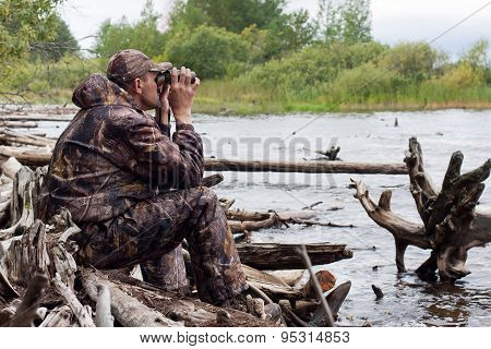 Sitting Hunter With Binoculars