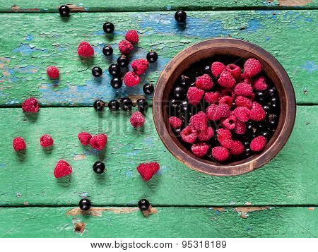 Summer Berries In The Bowl On Old Rustic Wooden Background.