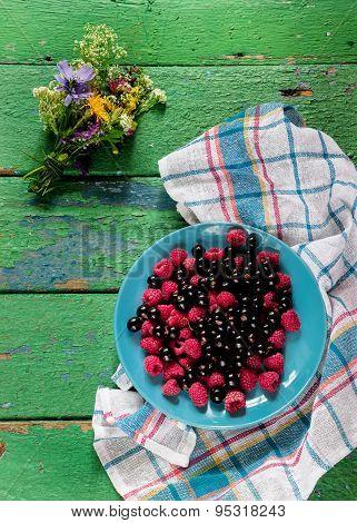 Summer Berries On Blue Plate.