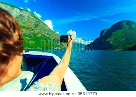 Tourism. Woman With Camera On Ship, Fjord In Norway.