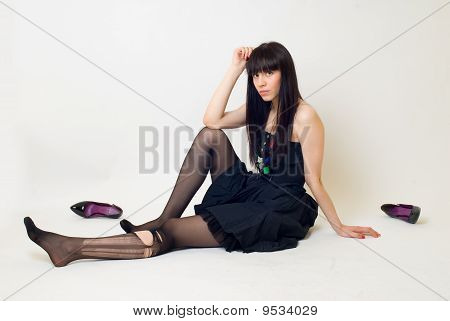 Young woman in torn stockings