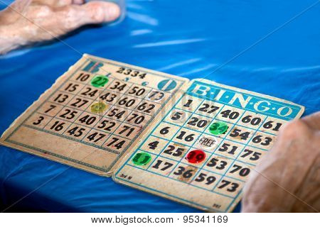 Bingo Cards Close-Up with Hands