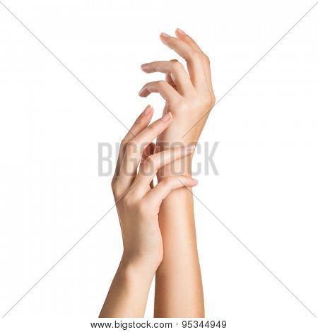Close up of woman's hands isolated on white background. Closeup shot of a woman applying moisturizer on her hand. Beautiful woman's hands gesturing with care.
